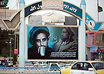 """5 June 2013, Mazar-i-Sharif, Afghanistan. A display of freedom fighter Ahmad Shah Massoud in the centre of town newer to The Shrine of Hazrat Ali, also known as the Blue Mosque, is a mosque in Mazar-i-Sharif, Afghanistan. It is one of the reputed burial places of Ali ibn Abi Talib, cousin and son-in law of Muhammad. The mazar is the building which gives the city in which it is located, Mazar-i-Sharif (meaning """"Tomb of the Exalted"""") its name. Picture by Graham Crouch/World Bank"""