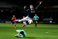 23rd February 2021; Kenilworth Road, Luton, Bedfordshire, England; English Football League Championship Football, Luton Town versus Millwall; Simon Sluga of Luton Town collects the ball as Tom Bradshaw of Millwall flies overhead