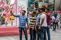 Young Men Posing for a Selfie outside Pavilion Mall, Bukit Bintang, Kuala Lumpur, Malaysia.