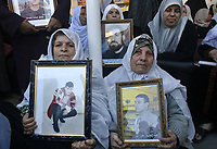 """Palestinian women hold pictures of prisoners held in Israeli jails during a weekly protest calling for their release, outside the International Red Cross building in Gaza City, Monday, Nov. 26, 2007. Israel's Cabinet agreed recently to free 441 of more than 9,000 Palestinians held in Israeli prisons. A Mideast summit was getting under way Monday in Washington, with President George W. Bush inviting the Israeli and Palestinian leaders to separate meetings at the White House. The centerpiece of the gathering will be an all-day session Tuesday in Annapolis, Maryland, to be attended by representatives of 16 Arab countries, including Saudi Arabia and Syria. (photo by Fady Adwan"""""""