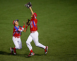 ABERDEEN, MD - AUGUST 04: Lucas Torres #11 of Puerto Rico jumps to make a catch while almost colliding with Derek Gipson #5 of Puerto Rico in the 2nd inning in a semifinal game between Puerto Rico and Mexico during the Cal Ripken World Series at The Ripken Experience Powered by Under Armour on August 4, 2016 in Aberdeen, Maryland. (Photo by Ripken Baseball/Eclipse Sportswire/Getty Images)