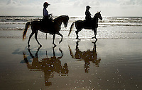 "Kelly.Jordan@jacksonville.com--042611--Pam Murphy, of Nocatee, riding Diamonte, right, and her friend Ellen O'Brien, of Palm Valley, riding Bandit head out on to the beach from Mickler's Landing for a morning of beach riding Tuesday, April 26, 2011. The riders are friends who try to ride on the beach as often as possible, the horses are PasoFino and 1/2 brothers who enjoy wading through the surf. As a beach rider for over 29 years,  Ellen says, "" riding along the ocean for an equestrian is tantamount to a golfer playing a round at Augusta National.""(The Florida Times-Union, Kelly Jordan)"
