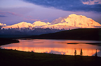 Mt. Denali, orange alpenglow on Denali's north face, Denali National Park, Alaska.