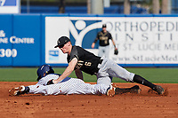 Army West Point shortstop Trey Martin (6) attempts to tag Jonathan Engelmann (2) stealing second base during a game against the Michigan Wolverines on February 18, 2018 at First Data Field in St. Lucie, Florida.  Michigan defeated Army 7-3.  (Mike Janes/Four Seam Images)