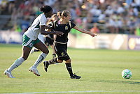 Tina Ellertson (right) pursues Tiffany Milbrett (right) as Milbrett signals to a teammate. FC Gold Pride tied the St. Louis Athletica 1-1 at Buck Shaw Stadium in Santa Clara, California on August 9, 2009.