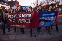 """AfD protestiert in Berlin gegen die Fluechtlingspolitik der Bundesregierung.<br /> Am Samstag den 31. Oktober 2015 versammelten sich ca. 250 Anhaenger der Rechts-Partei Alternative fuer Deutschland (AfD) zu einer Kundgebung gegen die Fluechtlings- und Asylpolitik der Bundesregierung. Dabei wurde die Bundeskanzlerin Angela Merkel mehrfach scharf angegriffen. Die Berichterstattung ueber Fluechtlinge in den Medien wurde mit lautstarken Rufen """"Luegenpresse"""" beschimpft.<br /> Der brandenburgische Landesvorsitzende Gauland forderte eine Fluechtlingspolitik wie in Japan, wo angeblich nur 20 Fluechtlinge pro Jahr aufgenommen werden.<br /> Etwa 350 Menschen protestierten gegen die Veranstaltung der Rechten und blockierten kurzzeitig deren Marschroute. Die Polizei ordnete daraufhin eine verkuerzte Route an und raeumte dafuer der AfD den Weg frei.<br /> Im Bild vlnr. am Transparent: Marcus Pretzell, AfD-Landesvorsitzender aus Nordrhein-Westfalen; Beatrix Amelie Ehrengard Eilika von Storch, geborene Herzogin von Oldenburg, stellvertretende AfD-Vorsitzende; ; Alexander Gauland, AfD-Landesvorsitzender aus Brandenburg.<br /> 31.10.2015, Berlin<br /> Copyright: Christian-Ditsch.de<br /> [Inhaltsveraendernde Manipulation des Fotos nur nach ausdruecklicher Genehmigung des Fotografen. Vereinbarungen ueber Abtretung von Persoenlichkeitsrechten/Model Release der abgebildeten Person/Personen liegen nicht vor. NO MODEL RELEASE! Nur fuer Redaktionelle Zwecke. Don't publish without copyright Christian-Ditsch.de, Veroeffentlichung nur mit Fotografennennung, sowie gegen Honorar, MwSt. und Beleg. Konto: I N G - D i B a, IBAN DE58500105175400192269, BIC INGDDEFFXXX, Kontakt: post@christian-ditsch.de<br /> Bei der Bearbeitung der Dateiinformationen darf die Urheberkennzeichnung in den EXIF- und  IPTC-Daten nicht entfernt werden, diese sind in digitalen Medien nach §95c UrhG rechtlich geschuetzt. Der Urhebervermerk wird gemaess §13 UrhG verlangt.]"""