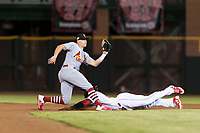 Surprise Saguaros second baseman Andy Young (29), of the St. Louis Cardinals organization, covers the base on a stolen base attempt by Taylor Trammell (26) during an Arizona Fall League game against the Scottsdale Scorpions at Scottsdale Stadium on October 15, 2018 in Scottsdale, Arizona. Surprise defeated Scottsdale 2-0. (Zachary Lucy/Four Seam Images)