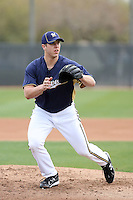 Cody Scarpetta #72 of the Milwaukee Brewers participates in pitchers fielding practice during spring training workouts at the Brewers complex on February 18, 2011  in Phoenix, Arizona. .Photo by Bill Mitchell / Four Seam Images.