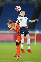 YOKOHAMA, JAPAN - JULY 30: Becky Sauerbrunn #4 of the United States and Vivianne Miedema #9 of the Netherlands jump up for a header during a game between Netherlands and USWNT at International Stadium Yokohama on July 30, 2021 in Yokohama, Japan.
