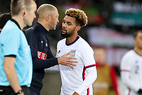SWANSEA, WALES - NOVEMBER 12: United States head coachGregg Berhalter and Konrad De la Fuente #11 on the sideline during a game between Wales and USMNT at Liberty Stadium on November 12, 2020 in Swansea, Wales.