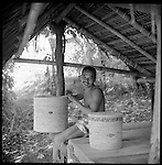 Indonesians are excellent craftsmen and craftswomen. Woodcarving, ceramics, silver and gold work are just a few of their skills. Here a craftsman weaves a basket in the hills of Bali. Palm leaves are used on every Indonesian island to make baskets, bags and mats.
