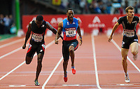 06 JUL 2012 - PARIS, FRA - Tyson Gay of the USA (centre) beats Justin Gatlin of the USA (left) and Christophe Lemaitre of France (right) to the finish line to win the men's 100m race at the 2012 Meeting Areva held in the Stade de France in Paris, France .(PHOTO (C) 2012 NIGEL FARROW)