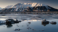 Spring landscape of ice floes moving out of Turnagain Arm on a spring morning w/ the snow-covered Kenai Mountains in the background.<br /> <br /> Photo by Jeff Schultz/  (C) 2020  ALL RIGHTS RESERVED
