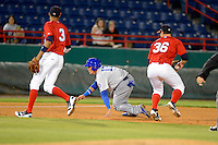 Daytona Cubs shortstop Javier Baez #12 avoids the tag of pitcher Mark Williams #36 during a run down as Yadiel Rivera #3 gets in position during a game against the Brevard County Manatees at Spacecoast Stadium on April 5, 2013 in Melbourne, Florida.  Baez was called out due to leaving the base path.  Daytona defeated Brevard County 8-0.  (Mike Janes/Four Seam Images)