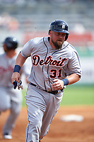 Detroit Tigers third baseman Casey McGehee (31) running the bases during a Spring Training game against the New York Yankees on March 2, 2016 at George M. Steinbrenner Field in Tampa, Florida.  New York defeated Detroit 10-9.  (Mike Janes/Four Seam Images)