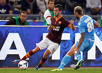 Calcio, Serie A: Roma vs Napoli. Roma, stadio Olimpico, 18 ottobre 2013.<br /> AS Roma midfielder Miralem Pjanic, of Bosnia, left, is challenged by Napoli midfielder Valon Behrami, of Switzerland, during the Italian Serie A football match between AS Roma and Napoli at Rome's Olympic stadium, 18 October 2013.<br /> UPDATE IMAGES PRESS/Riccardo De Luca