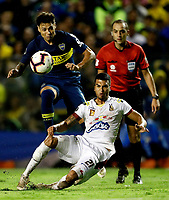 "BUENOS AIRES-ARGENTINA, 12-03- 2019: Mauro Zarate de Boca Juniors (ARG) disputa el balón con Juan Arboleda de Deportes Tolima (COL), durante partido de la fase de grupos, grupo G, fecha 2, entre Boca Juniors (ARG) y Deportes Tolima (COL), por la Copa Conmebol Libertadores 2019, en el estadio Alberto J. Armando ""La Bombonera"", de la ciudad Ciudad Autónoma de Buenos Aires. / Mauro Zarate of Boca Juniors (ARG) vies for the ball with Juan Arboleda of Deportes Tolima (COL), during a match of the groups phase, group G, 2nd date, beween Boca Juniors (ARG) and  Deportes Tolima (COL), for the Conmebol Libertadores Cup 2018, at the Alberto J. Armando ""La Bombonera"" Stadium, in Ciudad Autonoma de Buenos Aires. VizzorImage / Javier García Martino / Photogamma / Cont."