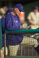 Western Carolina Catamounts head coach Bobby Moranda takes notes during the game against the Saint Joseph's Hawks at TicketReturn.com Field at Pelicans Ballpark on February 23, 2020 in Myrtle Beach, South Carolina. The Hawks defeated the Catamounts 9-2. (Brian Westerholt/Four Seam Images)