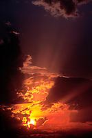 A dramatic, fiery sunrise over Kansas plains.