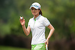 CHON BURI, THAILAND - FEBRUARY 16:  Shinobu Morimizato of Japan waves to the crowd after a putt on the 16th green during day one of the LPGA Thailand at Siam Country Club on February 16, 2012 in Chon Buri, Thailand.  Photo by Victor Fraile / The Power of Sport Images