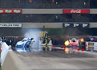 Jun 2, 2018; Joliet, IL, USA; NHRA funny car driver John Force (left) loses control and crashes into the wall alongside daughter Courtney Force during qualifying for the Route 66 Nationals at Route 66 Raceway. Force would walk away from the crash. Mandatory Credit: Mark J. Rebilas-USA TODAY Sports