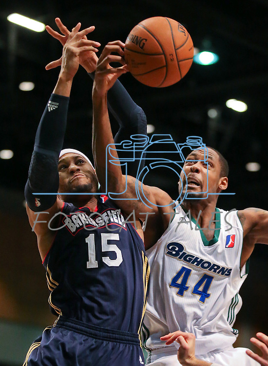 Bakersfield Jam's Billy Baptist and Reno Bighorns' Mickell Gladness battle for a loose ball during a D-League basketball game in Reno, Nev., on Tuesday, Jan. 14, 2014. The Bighorns won 93-85, improving to 11-9. <br />