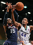 Bakersfield Jam's Billy Baptist and Reno Bighorns' Mickell Gladness battle for a loose ball during a D-League basketball game in Reno, Nev., on Tuesday, Jan. 14, 2014. The Bighorns won 93-85, improving to 11-9. <br /> Photo by Cathleen Allison