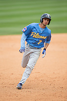 Daniel Lockhart (7) of the Myrtle Beach Pelicans hustles towards third base against the Winston-Salem Dash at BB&T Ballpark on May 10, 2015 in Winston-Salem, North Carolina.  The Pelicans defeated the Dash 4-3.  (Brian Westerholt/Four Seam Images)