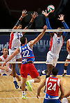 Puerto Rico's Josue Rivera hits against Dominican Republic blockers Cruz Mercedes and Wilfrido Hernandez during the Pan American Cup at the Reno Events Center in Reno, Nev., on Monday, Aug. 17, 2015. <br /> Photo by Cathleen Allison
