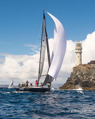 Sailing round the Fastnet Rock at Calves Week 2019 Photo: Bob Bateman