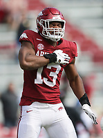 Arkansas defensive lineman Julius Coates (13) reacts following a sack, Saturday, October 17, 2020 during the first quarter of a football game at Donald W. Reynolds Razorback Stadium in Fayetteville. Check out nwaonline.com/201018Daily/ for today's photo gallery. <br /> (NWA Democrat-Gazette/Charlie Kaijo)