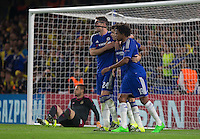 Teammates congratulate Oscar (centre) of Chelsea on his goal from the penalty spot making it 2-0 during the UEFA Champions League match between Chelsea and Maccabi Tel Aviv at Stamford Bridge, London, England on 16 September 2015. Photo by Andy Rowland.