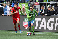 SEATTLE, WA - NOVEMBER 10: Victor Rodriguez #8 of the Seattle Sounders FC is chased by Nick DeLeon #18 of Toronto FC during a game between Toronto FC and Seattle Sounders FC at CenturyLink Field on November 10, 2019 in Seattle, Washington.