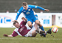Queen of the South's Daniel Carmichael is challenged by Arbroath's Mark Baxter.