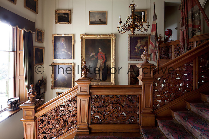Jacobean revival staircase with carved balustrade and newels