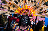 A Mexican woman, wearing a scull mask with a feather headdress, performs on the street during the Day of the Dead celebrations in Oaxaca, Mexico, 30 October 2019. Day of the Dead (Día de Muertos), a religious holiday combining the death veneration rituals of Pre-Hispanic cultures with the Catholic practice, is widely celebrated throughout all of Mexico. Based on the belief that the souls of the departed may come back to this world on that day, people gather together while either praying or joyfully eating, drinking, and playing music, to remember friends or family members who have died and to support their souls on the spiritual journey.