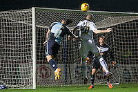 Gill Swerts of Notts County clears from Sam Wood of Wycombe Wanderers during the Sky Bet League 2 match between Wycombe Wanderers and Notts County at Adams Park, High Wycombe, England on 15 December 2015. Photo by Andy Rowland.