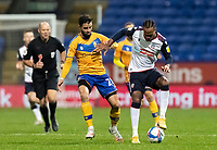 Bolton Wanderers' Nathan Delfouneso (right) competing with Mansfield Town's Stephen McLaughlin<br /> <br /> Photographer Andrew Kearns/CameraSport<br /> <br /> The EFL Sky Bet League Two - Bolton Wanderers v Mansfield Town - Tuesday 3rd November 2020 - University of Bolton Stadium - Bolton<br /> <br /> World Copyright © 2020 CameraSport. All rights reserved. 43 Linden Ave. Countesthorpe. Leicester. England. LE8 5PG - Tel: +44 (0) 116 277 4147 - admin@camerasport.com - www.camerasport.com