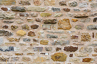 UK, England, Yorkshire.  Stone Work in the Wall of a New Yorkshire Cottage.