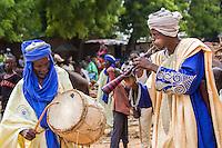 Court musician play kakaki in front of Kanta Museum. Argungu, Nigeria.