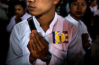 A follower, wearing a 969 sticker, of U Wirathu, the spiritual leader of the radical Buddhist 969 movement, waits for him to leave the prayer hall after delivering a sermon at the Thein Taung Monastery in Taunggyi, Shan State. /Felix Features