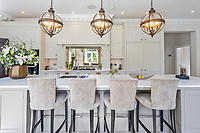 BNPS.co.uk (01202 558833)<br /> Pic: Savills/BNPS<br /> <br /> Pictured: The kitchen.<br /> <br /> A striking turreted French style chateau in one of the UK's most desirable streets is on the market for £9.25m.<br /> <br /> Deauville is an impressive mansion with a striking period exterior but a stylish contemporary look inside and all the mod cons a home owner would want, including an indoor pool complex and cinema room.<br /> <br /> The house is in the prestigious St George's Hill estate in Weybridge, Surrey, which is renowned all over the world.<br /> <br /> The five-bedroom house was built in 2000 but has undergone an extensive refurbishment in the last few years.