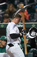 Harris Yett (8) of the Charlotte 49ers is presented with a giant pick-axe as he returns to the dugout after hitting a home run against the Clemson Tigers at BB&T BallPark on March 26, 2019 in Charlotte, North Carolina. The Tigers defeated the 49ers 8-5. (Brian Westerholt/Four Seam Images)
