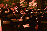 Washington, DC - June 1, 2020: DC Metropolitan Police form a line as protesters gather at 15th & Swann St. NW, Washington, DC  June 1, 2020, in the wake of the death of George Floyd by a Minnesota police officer.  (Photo by Don Baxter/Media Images International)