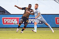 KANSAS CITY, UNITED STATES - AUGUST 25: Darwin Quintero #23 of Houston Dynamo holds off Johnny Russell of Sporting Kansas City  a game between Houston Dynamo and Sporting Kansas City at Children's Mercy Park on August 25, 2020 in Kansas City, Kansas.