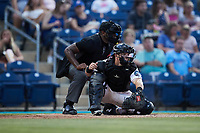 Kannapolis Cannon Ballers catcher Daniel Millwee (17) reaches for a pitch as home plate umpire Matt Blackborow looks on during the game against the Charleston RiverDogs at Atrium Health Ballpark on June 30, 2021 in Kannapolis, North Carolina. (Brian Westerholt/Four Seam Images)