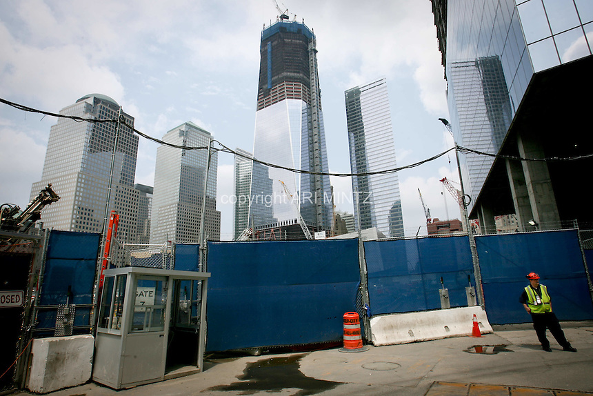 Tenth anniversary of 9/11.  Rebuilding at the World Trade Center site.  The view from Greenwich Street gate.  L to R: World Financial Center buildings, Goldman Sachs, under-construction 1 WTC, 7 WTC, and under-construction 4 WTC.  When the site is rebuilt Greenwich Street will once again be a thoroughfare through the site.  The previous World Trade Center bisected the street.  Photo by Ari Mintz.  8/7/2011.