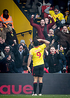 Troy Deeney of Watford salutes the supporters after scoring on his 300th league appearance for Watford during the Premier League match between Watford and West Bromwich Albion at Vicarage Road, Watford, England on 3 March 2018. Photo by Andy Rowland.