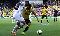 Luciano Narsingh of Swansea City is challenged by Adrian Mariappa of Watford the Premier League match between Watford and Swansea City at Vicarage Road Stadium, Watford, England, UK. Saturday 15 April 2017