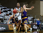 SIOUX FALLS, SD - MARCH 7: Naomie Alnatas #3 of the UMKC Kangaroos takes the ball to the basket past Mallory McDermott #11 of the Western Illinois Leathernecks during the Summit League Basketball Tournament at the Sanford Pentagon in Sioux Falls, SD. (Photo by Dave Eggen/Inertia)